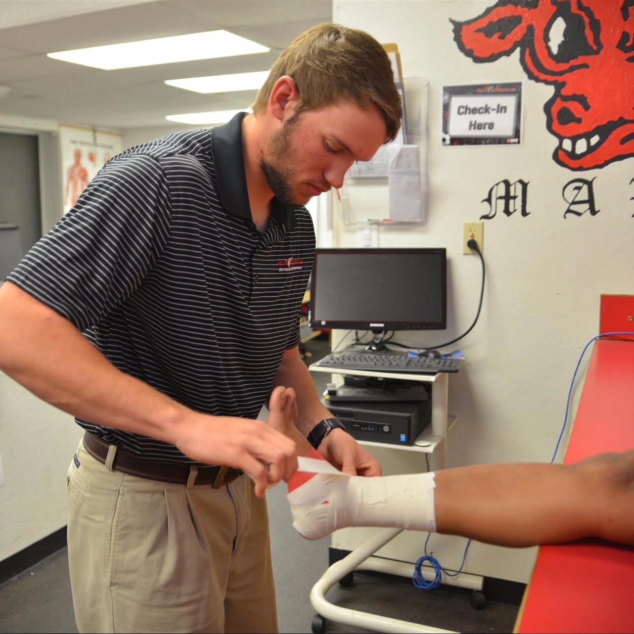Paden Morris taping an ankle